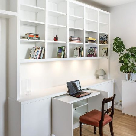 Contemporary modern fitted shelving with occasional pull out desk home office