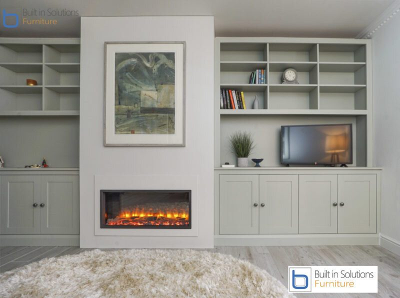 False chimney breast wall unit with electric fire and built in Alcove cupboards