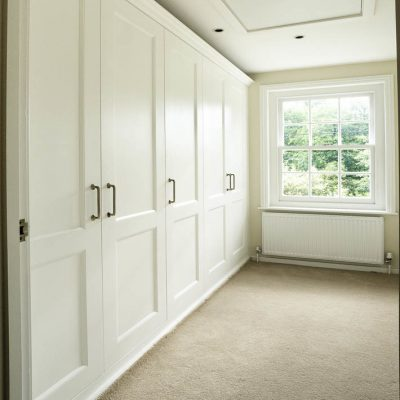 Fitted shaker wardrobes in a bedroom