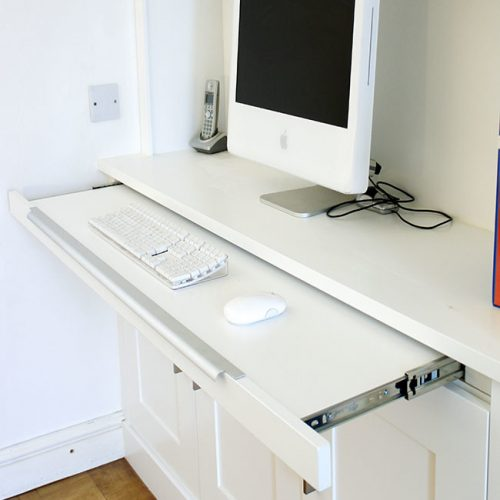 Home office workstation in an alcove cupboard