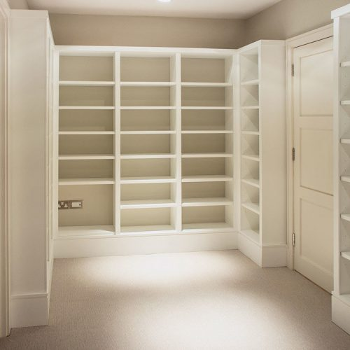 Large Home library room in white with lots of shelves