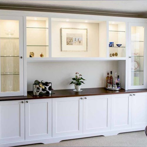 Large fitted dining room cupboards with glazed door display cabients