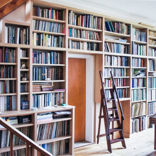 Large wall home library around doorway