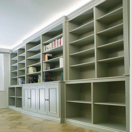 Large wall to wall built in Bookcases and cupboards in a traditional style painted in Farrow & ball mouses back