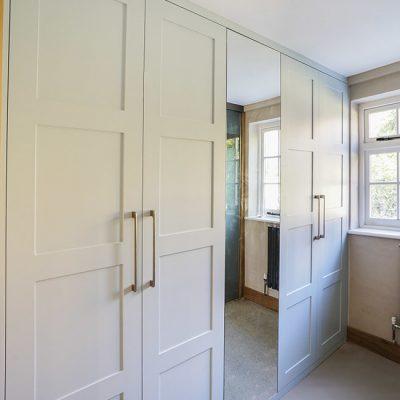 Modern fitted shaker wardrobe with mirror door