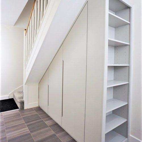 Modern built in wardrobe under stairs storage