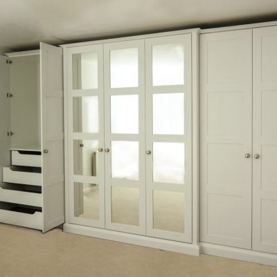 Wall-to-wall-shaker-wardrobe-with-mirrors-and-Break fornt