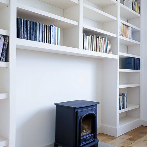 built in bookcases either side of fireplace