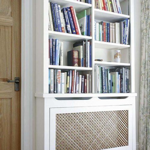 built in cupboards around radiator