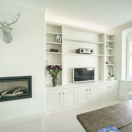 designer built in cupboards fitted into an alcove
