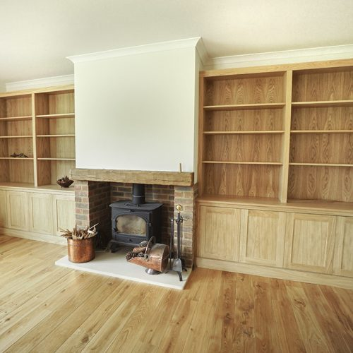 fitted cupboards around fireplace in Oak