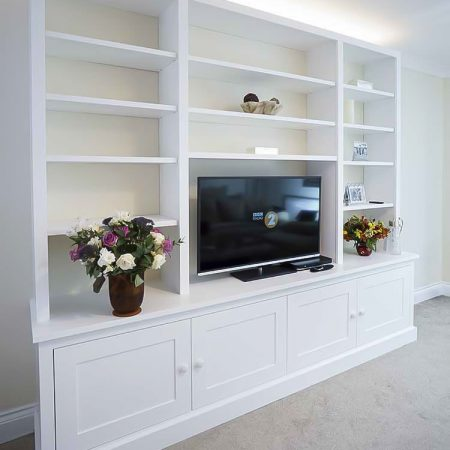lounge cabinets and shelves around a TV