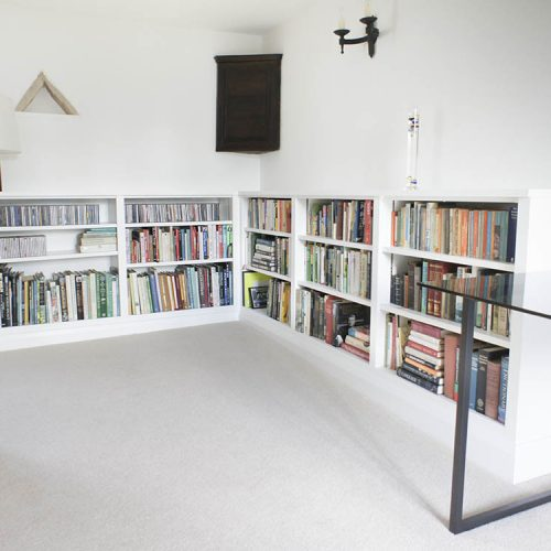 low level fitted bookcases in white