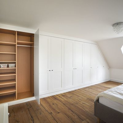 wall to wall white shaker built in wardrobe